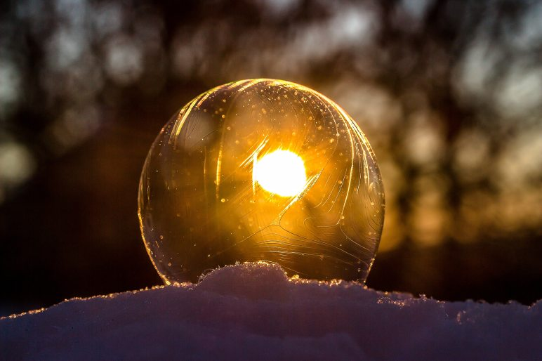 winter solstice 2018 soap bubble frosted with sunlight behind it